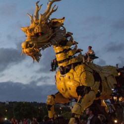 Fire-Breathing Dragon Walks the Streets of France